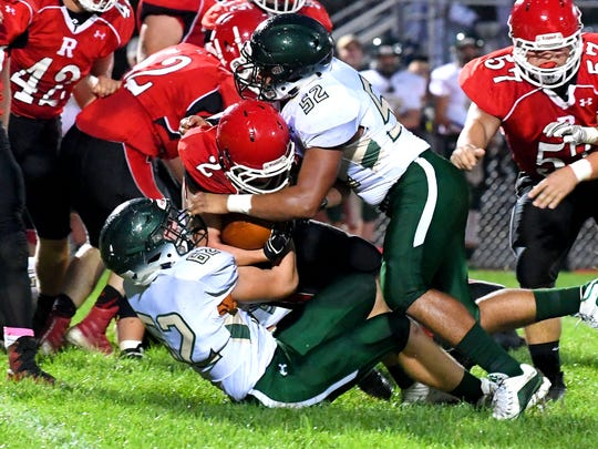 Riverheads' Devin Morris has the ball as he is caught between and dragged down by Wilson Memorial's Michael Holmes and Tony Carter during a game played in Greenville on Friday, Oct. 5, 2018.