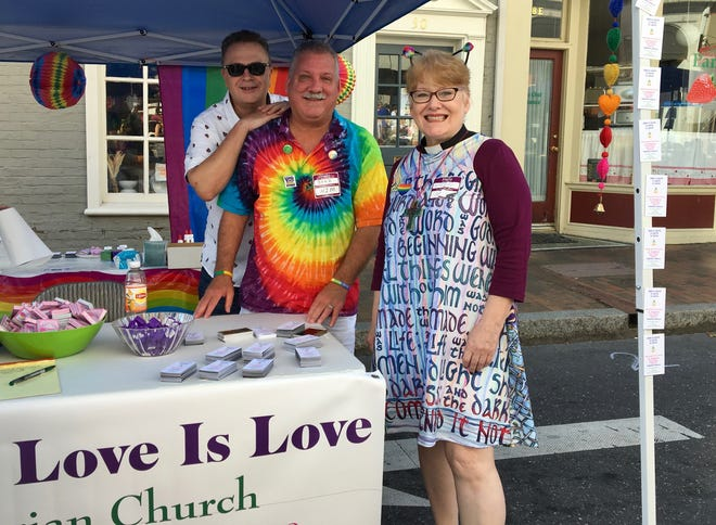 Married at First Presbyterian Church in Staunton, Gary Wilson and Brad Furr stand with their pastor, Rev. Karen Allamon, at Staunton Pride on Saturday, Oct. 6, 2018.