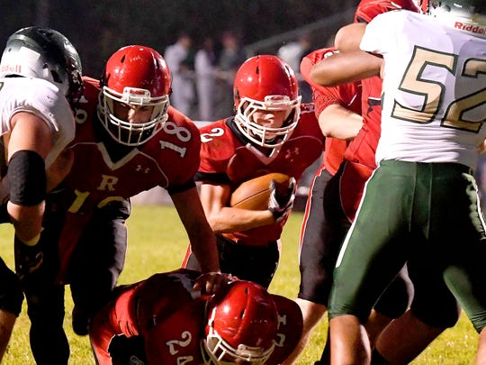 Riverheads' Devin Morris runs the football through a gap in the Wilson Memorial defensive line, opening by his teammates, as he heads to the end zone for a touchdown during a game played in Greenville on Friday, Oct. 5, 2018.