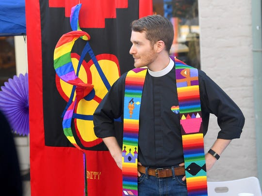 Chaplain Connor Gwin of Stuart Hall mans a booth at the Staunton Pride festival in downtown Staunton on Saturday, Oct. 6, 2018.