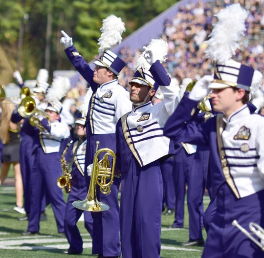 Members of the James Madison Marching Royal Dukes perform before the Dukes' 27-24 Colonial Athletic Association loss to Elon on Saturday, Oct. 6, 2018, at Bridgeforth Stadium in Harrisonburg, Va.