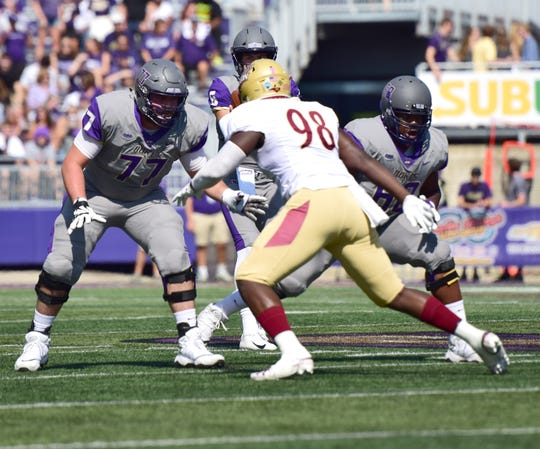 James Madison offensive lineman Liam Fornadel gets ready to block Elon's Marcus Willoughby during the first half of the the Dukes' 27-24 Colonial Athletic Association loss Saturday, Oct. 6, 2018, at Bridgeforth Stadium in Harrisonburg, Va.