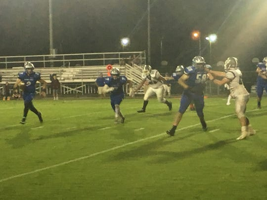 William Dod scores on a 2-point conversion run for Lee High Friday night.