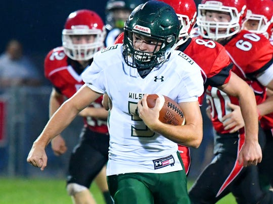 Wilson Memorial's Collin Firtzgerald runs the football for more yards during a game played in Greenville on Friday, Oct. 5, 2018.