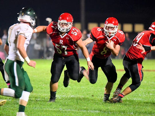 Riverheads' Colin Armstrong (left) makes sure the way is clear as teammate Zac Smiley runs the football during a game played in Greenville on Friday, Oct. 5, 2018.