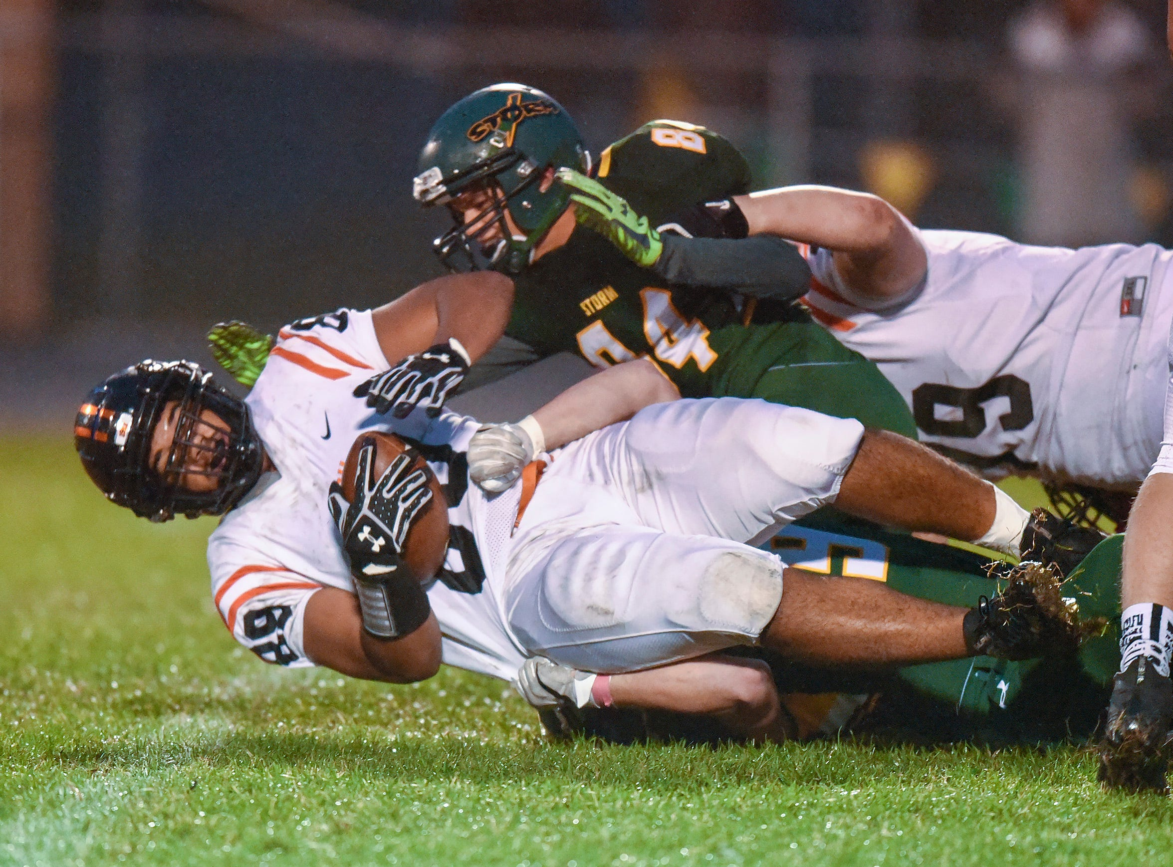 Tech's Major Campbell is brought down by the Sauk Rapids' defense during the first half Friday, Oct. 5, in Sauk Rapids.