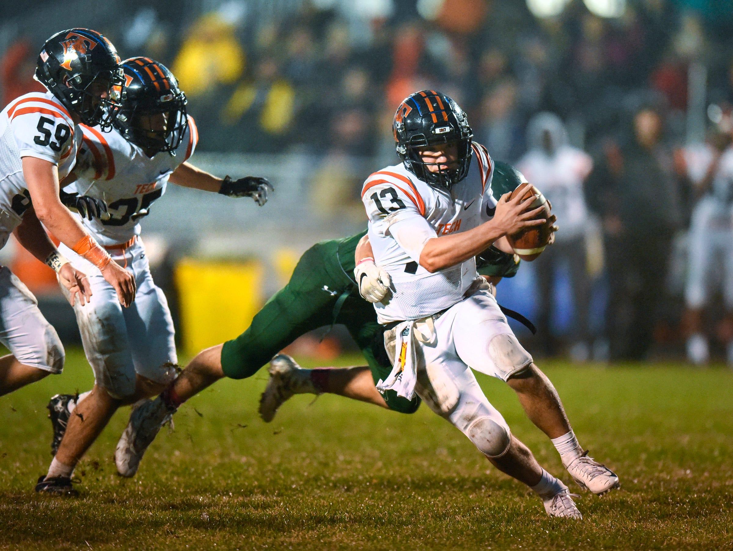 Tech quarterback Nate Trewick breaks free of a Sauk Rapids' tackle during the first half Friday, Oct. 5, in Sauk Rapids.