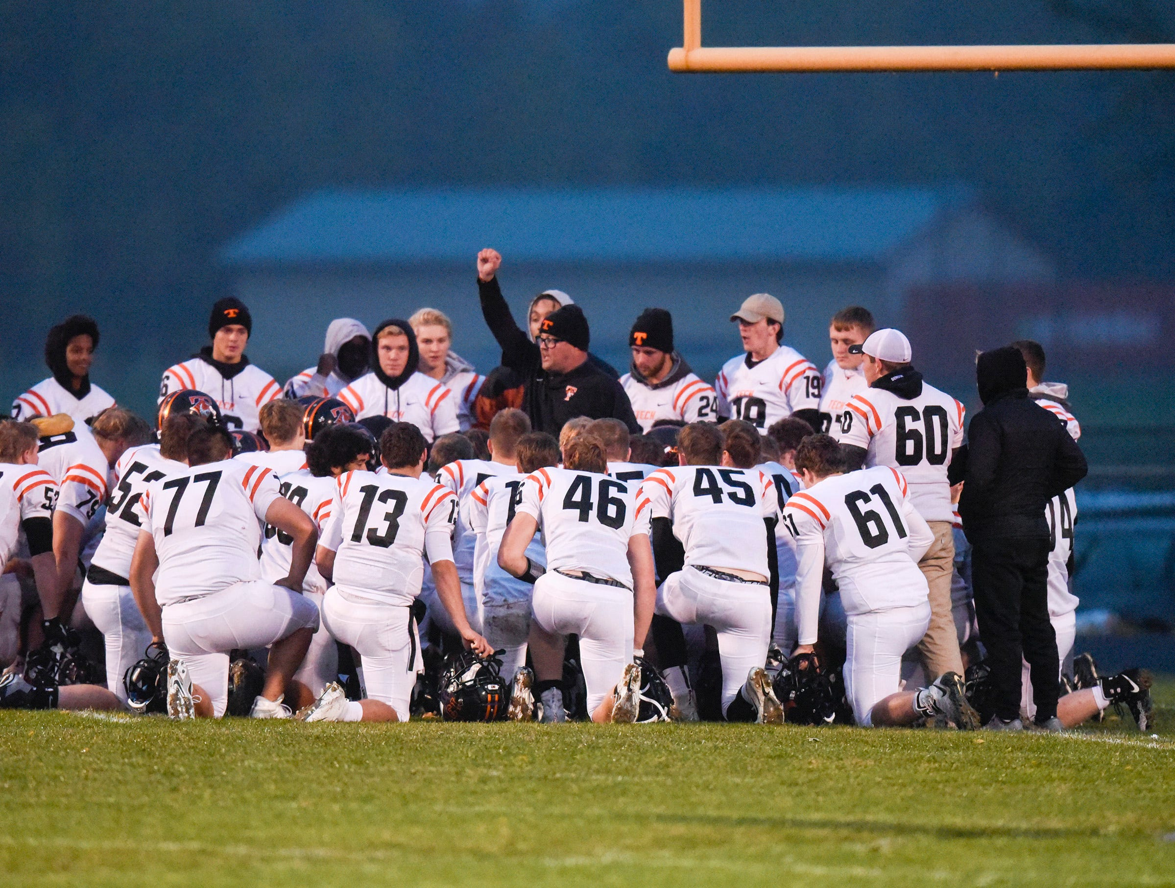Tech players and coaches talk before the start of their game against Sauk Rapids Friday, Oct. 5, in Sauk Rapids.