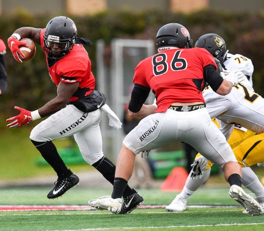 St. Cloud State running back Gregory Lewis carries the ball against Wayne State Saturday, Oct. 6, at Husky Stadium.