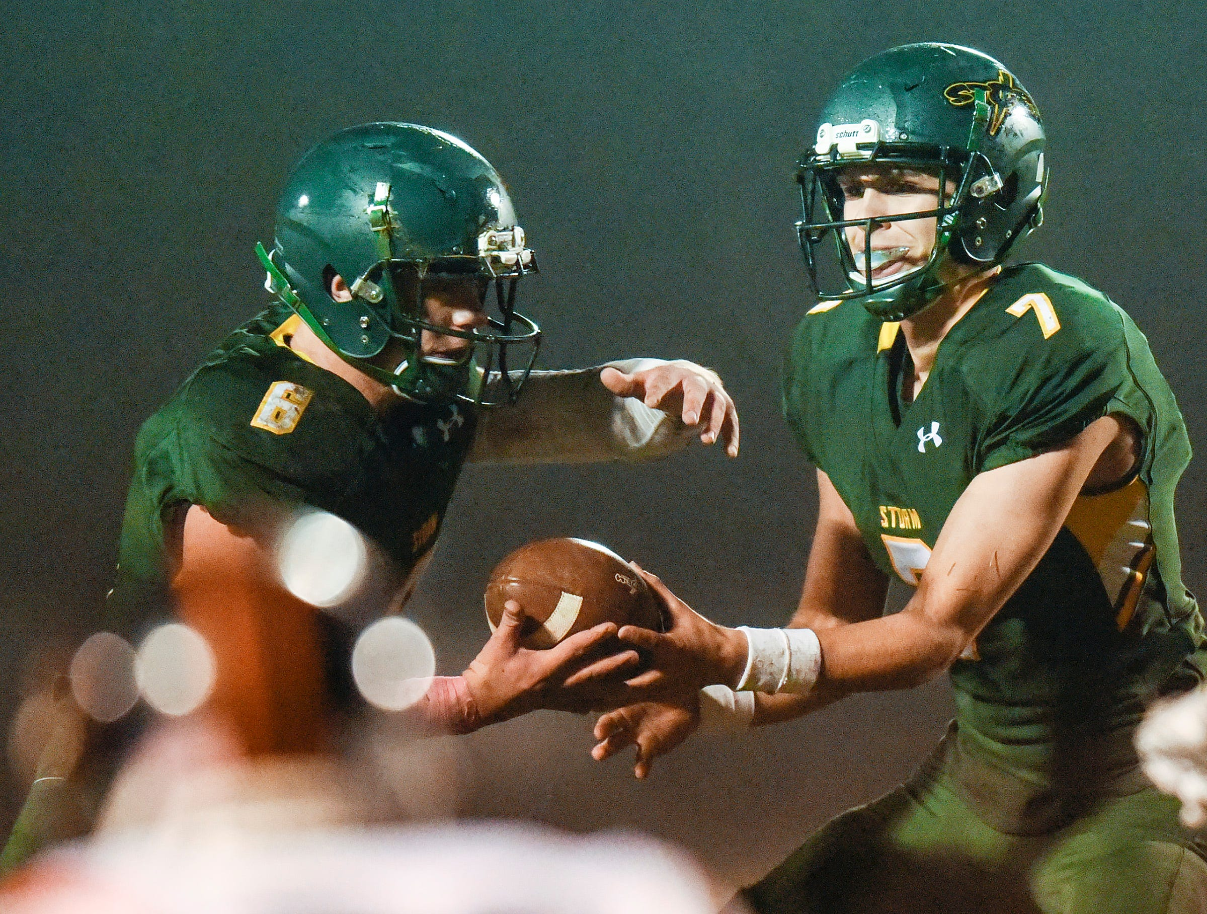 Sauk Rapids running back J.D. Bates takes the ball from quarterback Cade Milton-Baumgardner on a play against Tech during the first half Friday, Oct. 5, in Sauk Rapids.