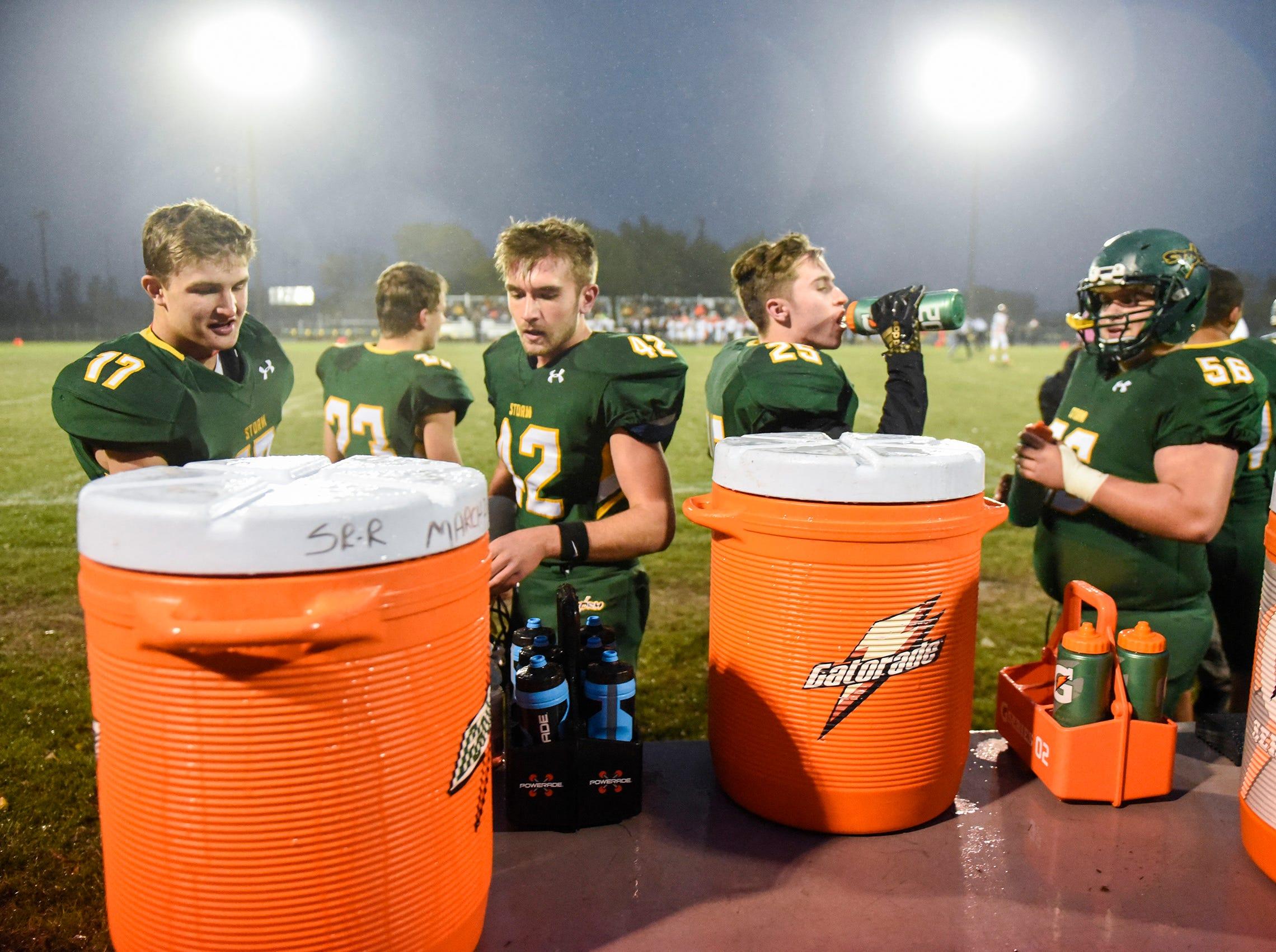 Sauk Rapids players take a drink during the first half Friday, Oct. 5, in Sauk Rapids.