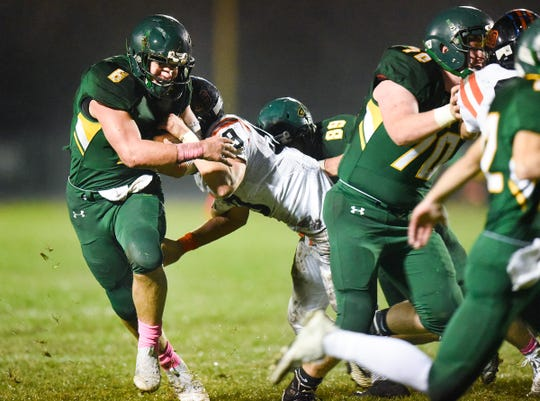 Sauk Rapids' running back J.D. Bates carries the ball against Tech during the first half Friday, Oct. 5, in Sauk Rapids.
