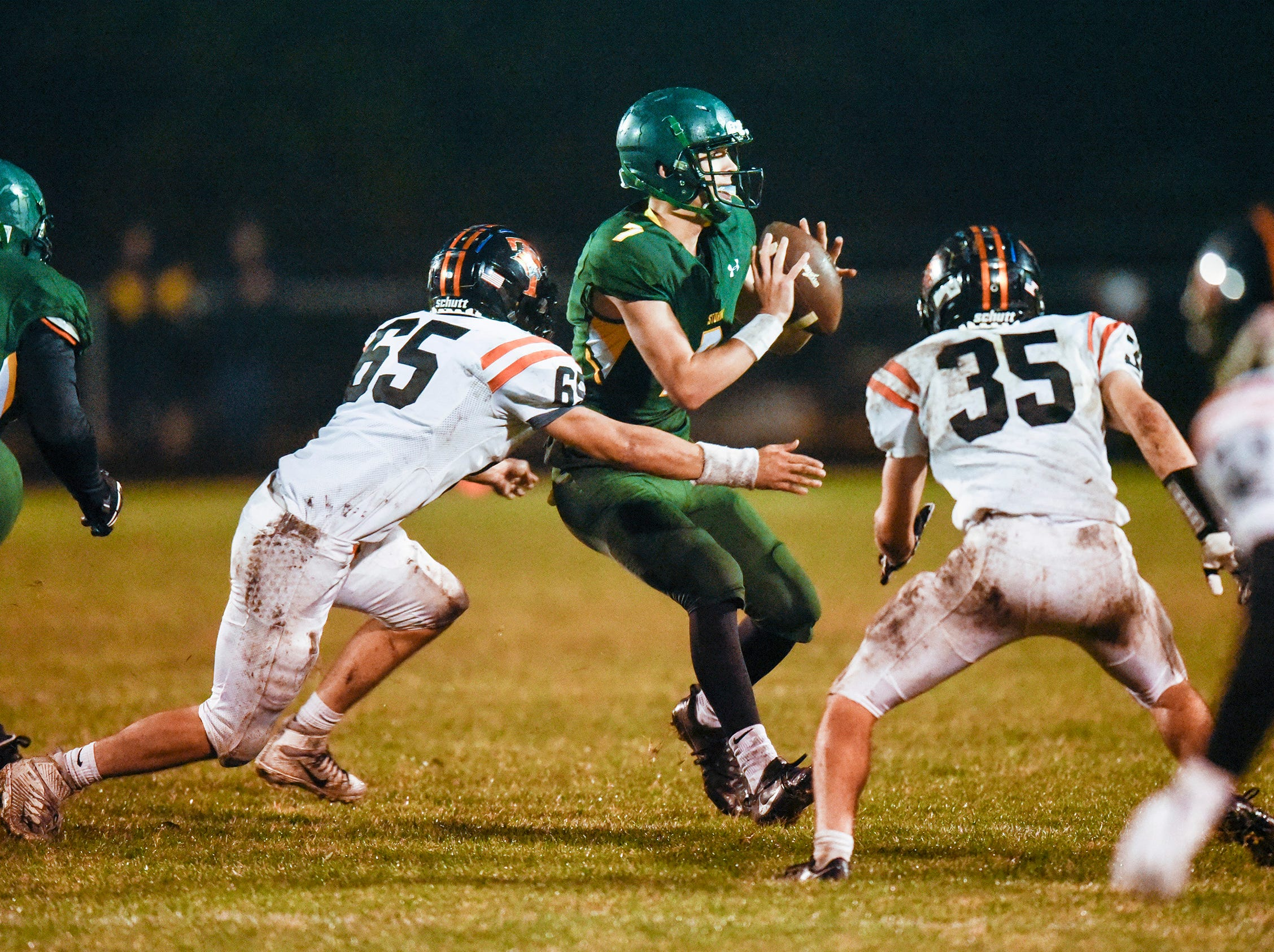 Sauk Rapids quarterback Cade Milton-Baumgardner is tackled by the Tech defense during the first half Friday, Oct. 5, in Sauk Rapids.