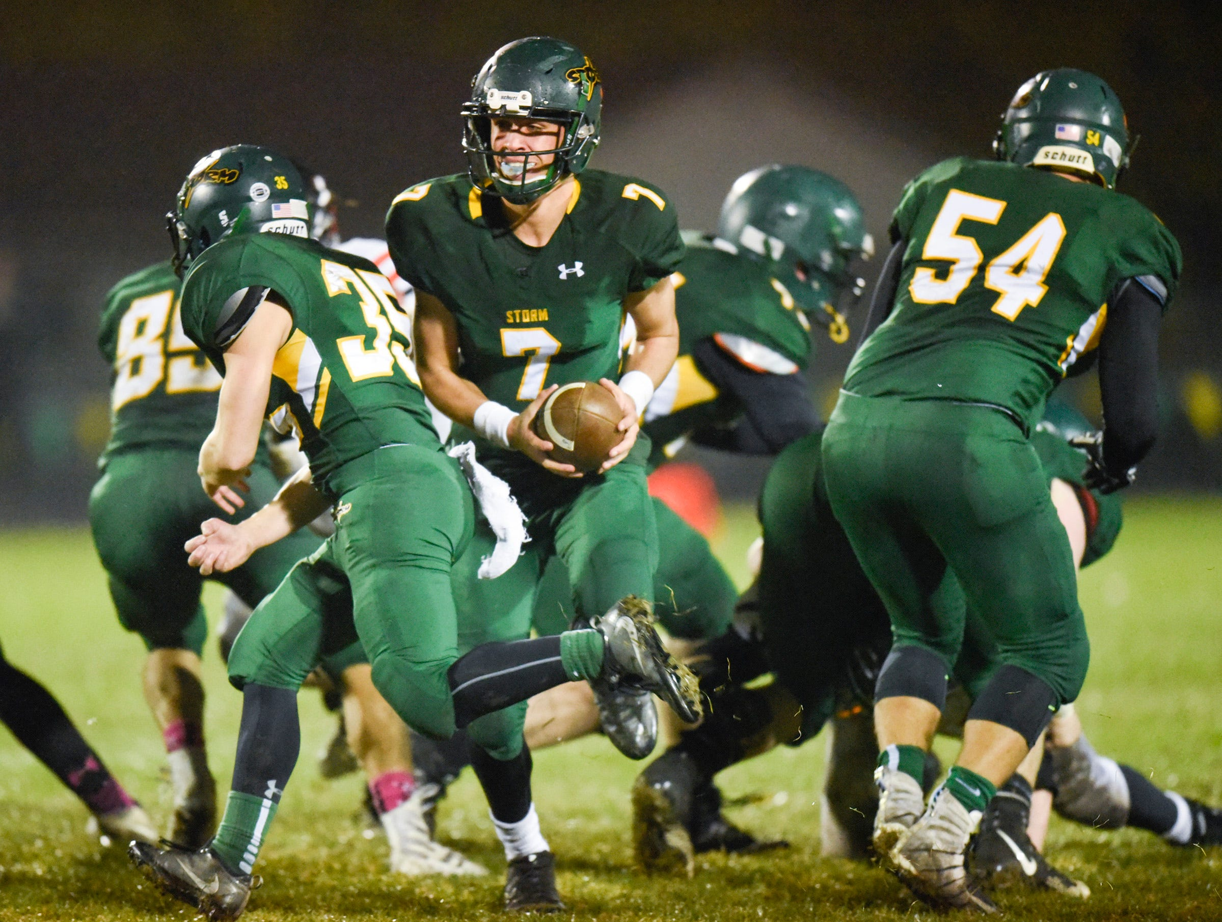 Sauk Rapids quarterback Cade Milton-Baumgardner rolls out with the ball against Tech during the first half Friday, Oct. 5, in Sauk Rapids.
