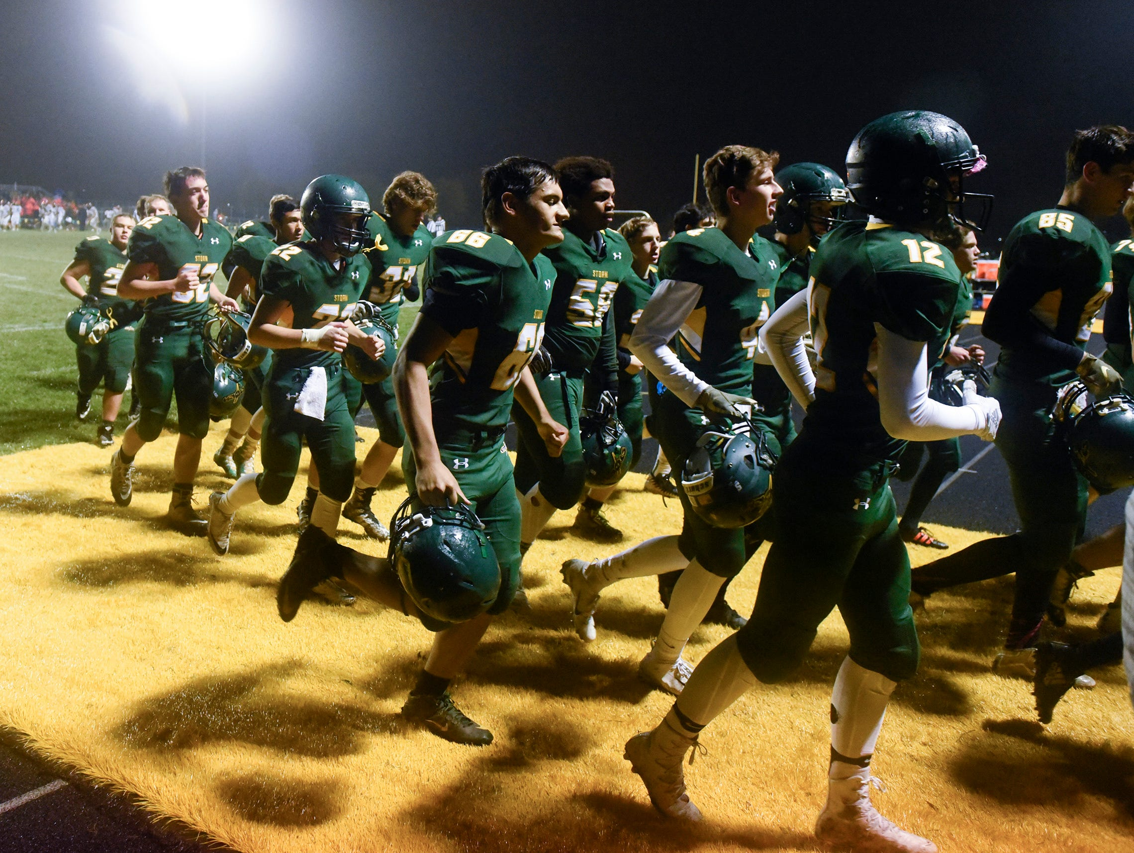 Sauk Rapids' players come off the field at halftime with a 27-6 lead over Tech Friday, Oct. 5, in Sauk Rapids.
