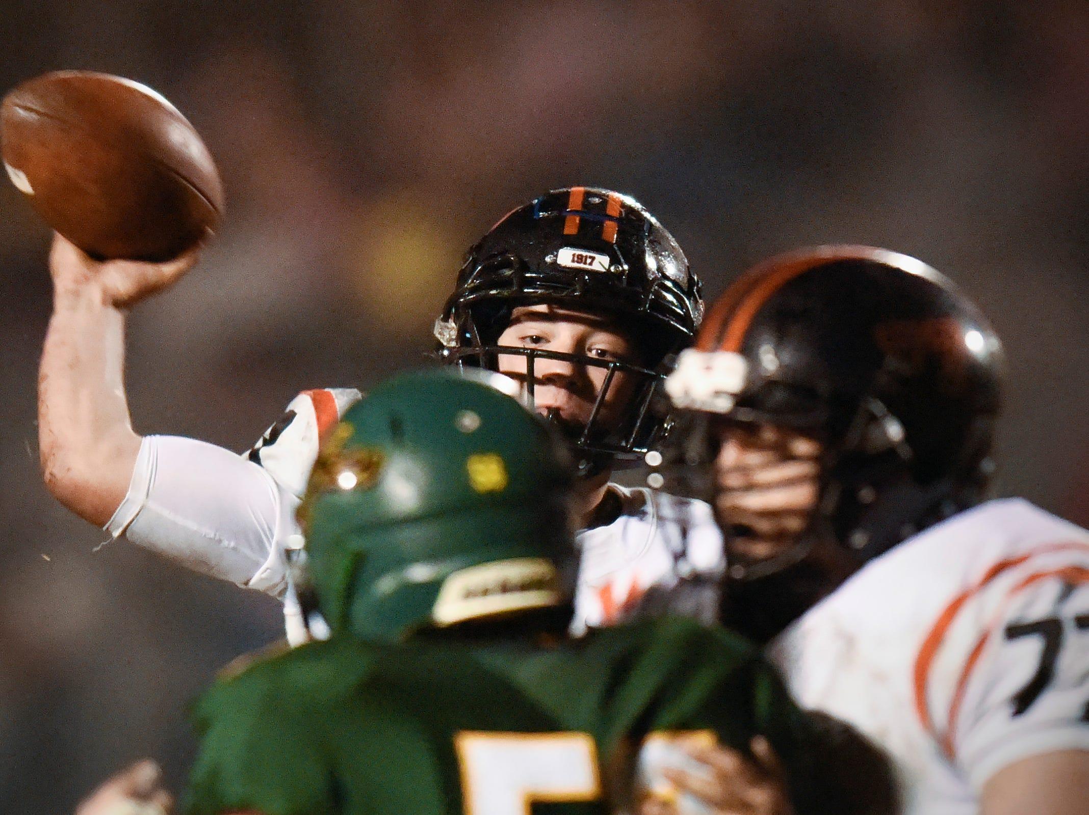 Tech quarterback Nate Trewick makes a pass against Sauk Rapids during the first half Friday, Oct. 5, in Sauk Rapids.