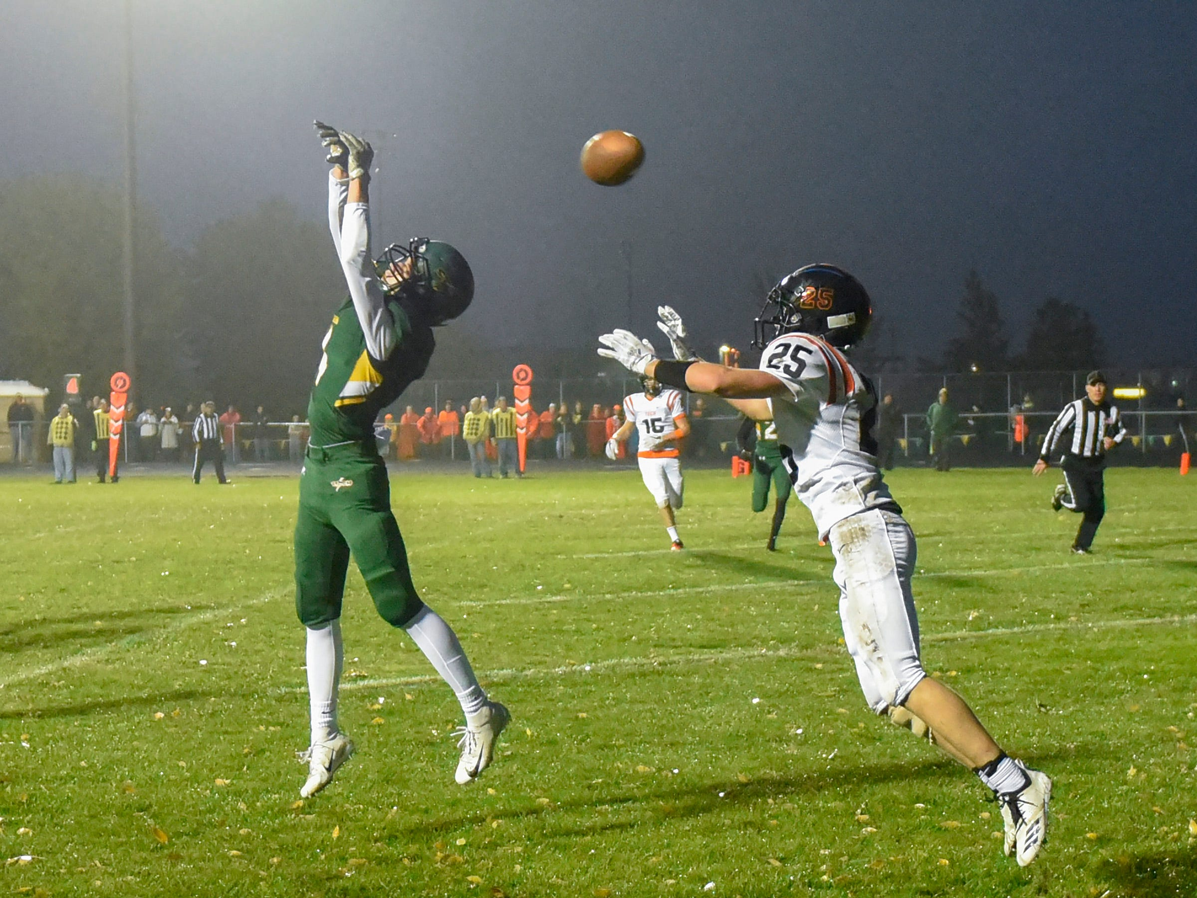 Sauk Rapids' Kobe Lee breaks up a pass to Tech's Hunter Stulz in the end zone during the first half Friday, Oct. 5, in Sauk Rapids.