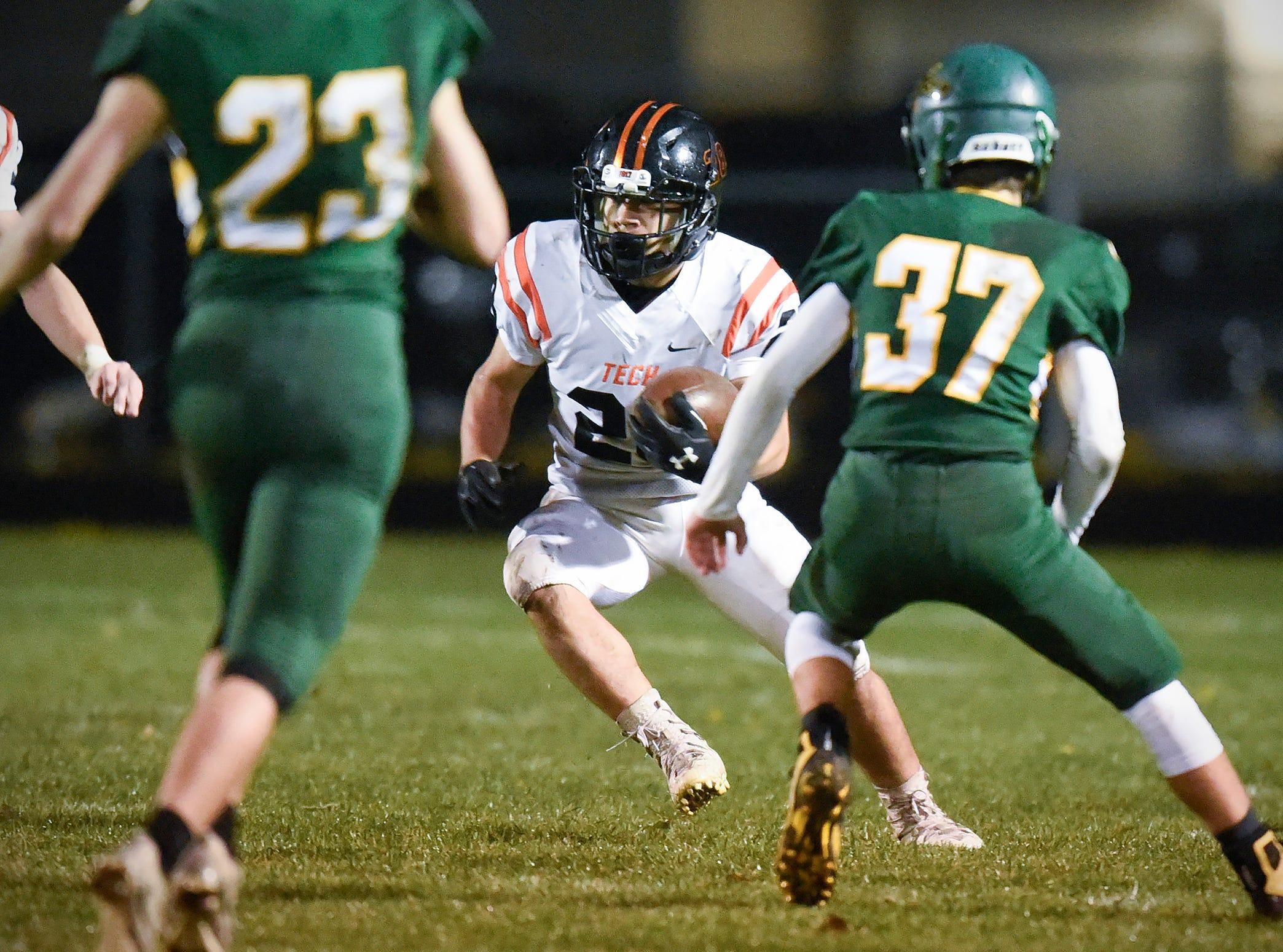Tech running back Aaron Bennett carries the ball against Sauk Rapids during the first half Friday, Oct. 5, in Sauk Rapids.