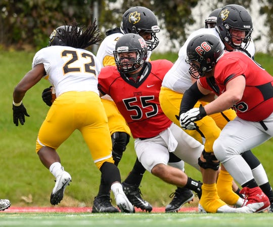 St. Cloud State's Jack Horter tackles Wayne State's Marlon Warren on a play in the first half Saturday, Oct. 6, at Husky Stadium.
