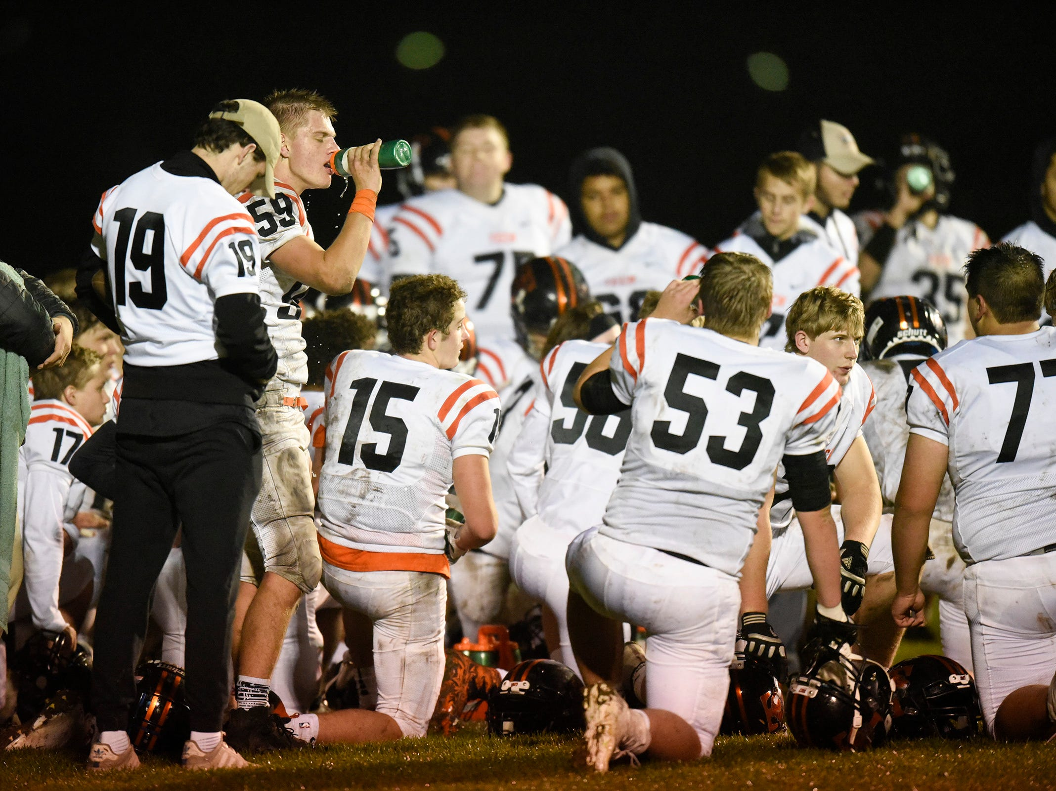 Tech players talk in the end zone during halftime against Sauk Rapids Friday, Oct. 5, in Sauk Rapids.