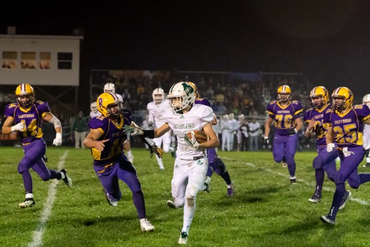 Almond-Bancroft wingback Zach Bunders looks to elude a host of Pittsville defenders. The Eagles secured a 34-7 win to lock up at least a tie for the Central Wisconsin Conference-Small title.