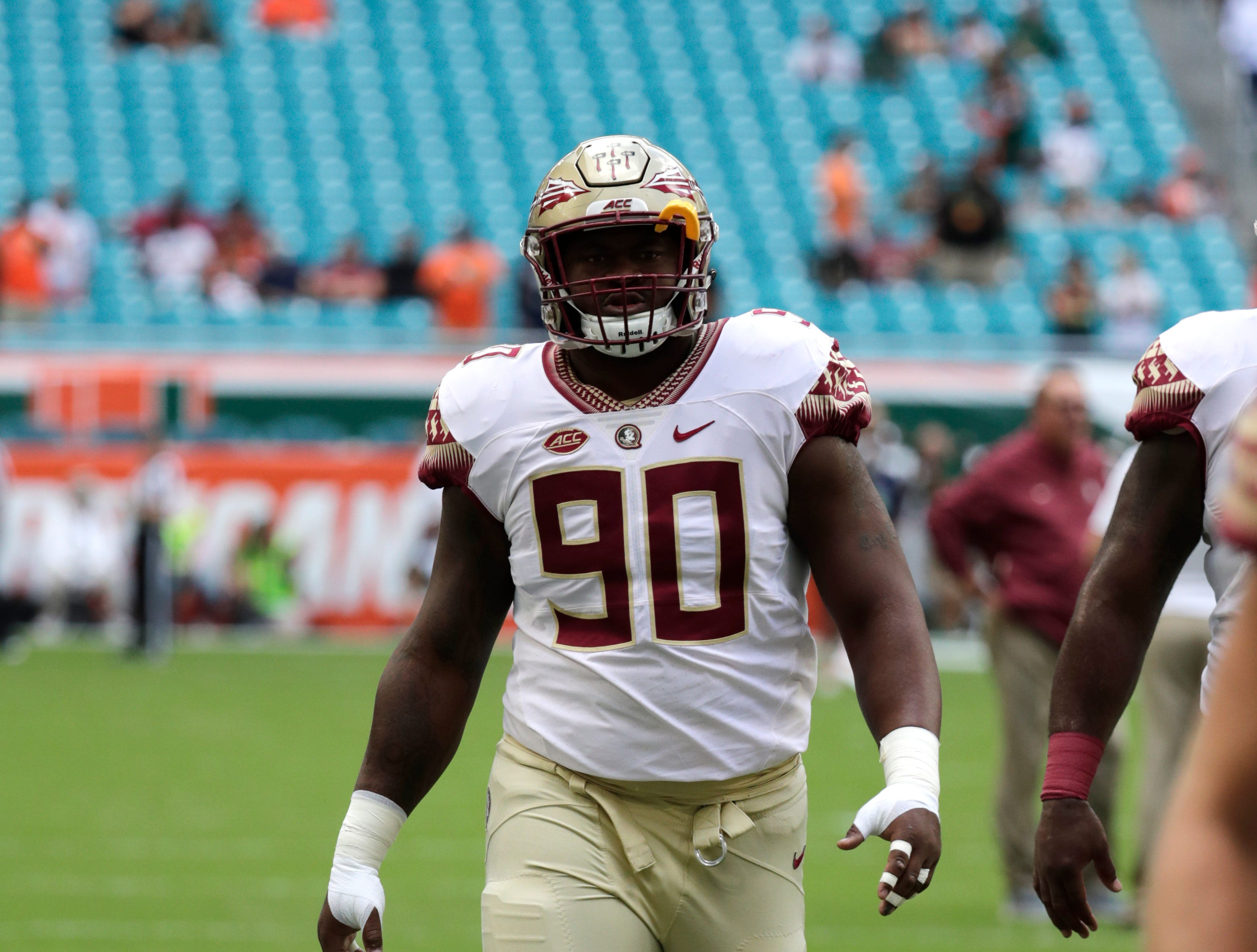 Florida State defensive tackle Demarcus Christmas warms up before an NCAA college football game against Miami, Saturday, Oct. 6, 2018, in Miami Gardens, Fla. (AP Photo/Lynne Sladky)