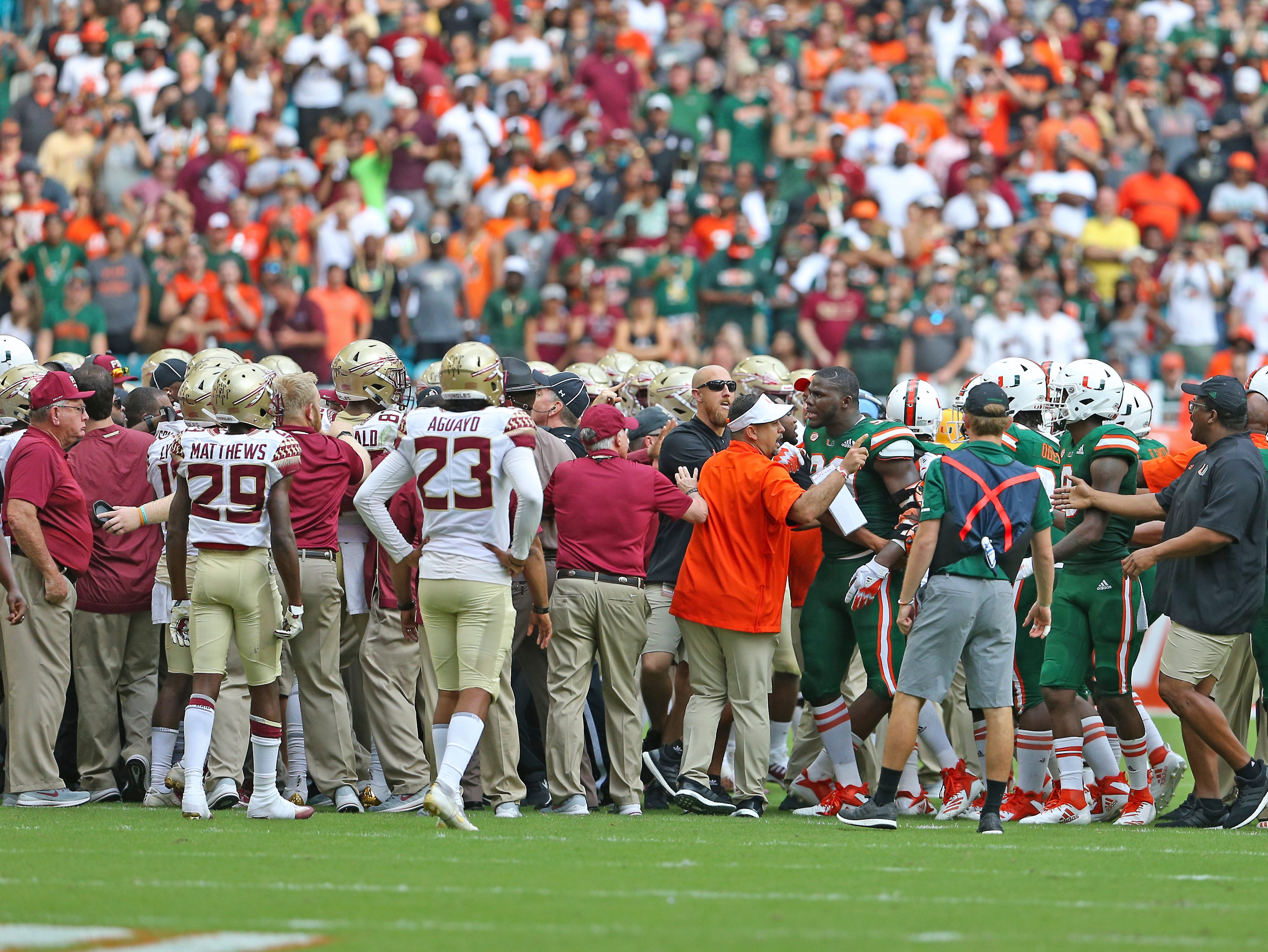 Players from University of Miami and Florida State push each other before the start of an NCAA college football game, Saturday, Oct. 6, 2018, in Miami Gardens, Fla. (David Santiago/Miami Herald via AP)