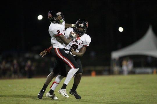 NFC defensive back Tredarious Langston (3) celebrates an interception with Quan Myrick (6) during a game at Florida High.
