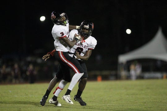 NFC defensive back Tredarious Langston (3) celebrates an interception with Quan Myrick (6) during a game at Florida High.