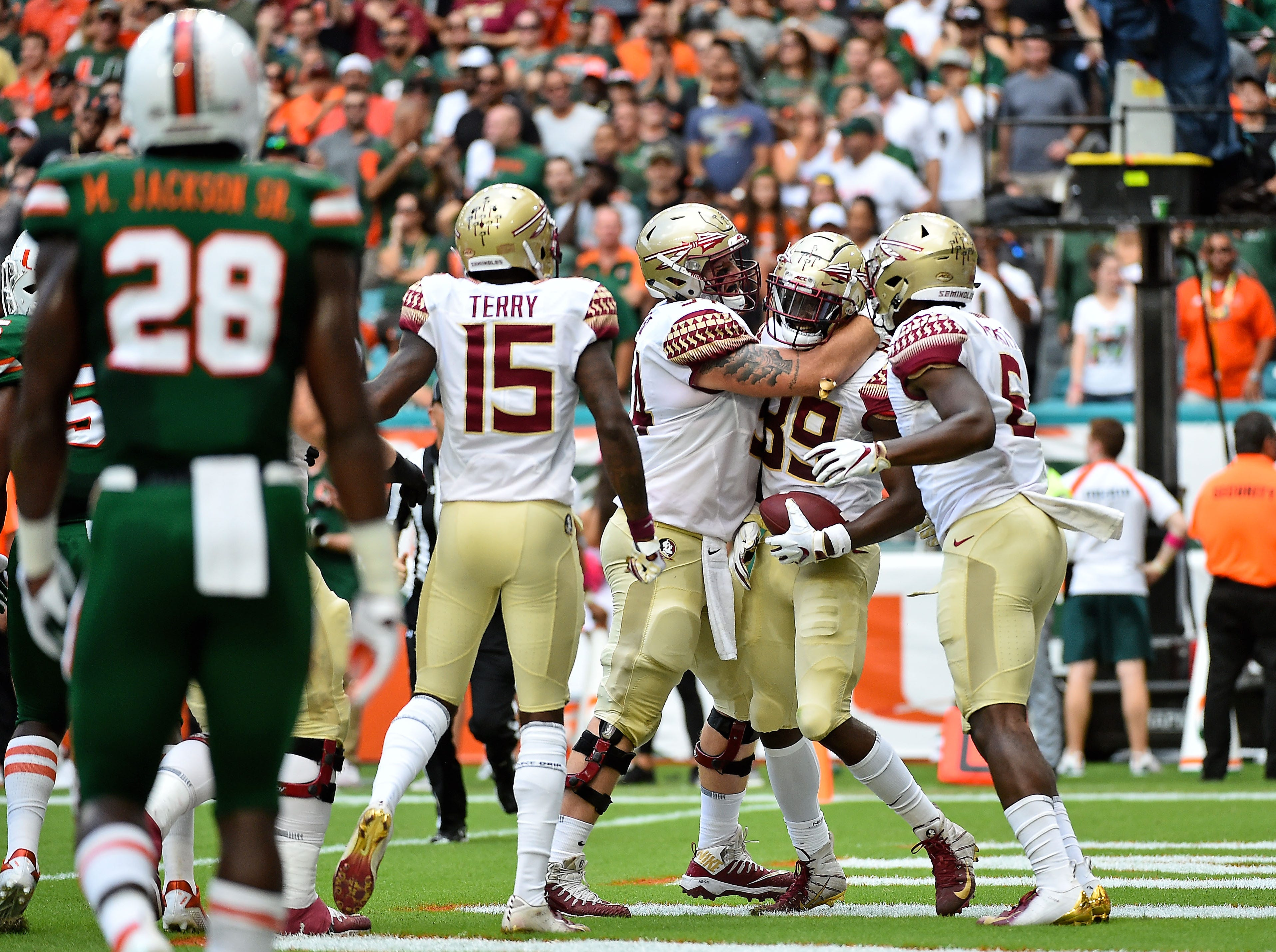 Oct 6, 2018; Miami Gardens, FL, USA; Florida State Seminoles wide receiver Keith Gavin (89) celebrates his touchdown against the Miami Hurricanes during the first half at Hard Rock Stadium. Mandatory Credit: Jasen Vinlove-USA TODAY Sports