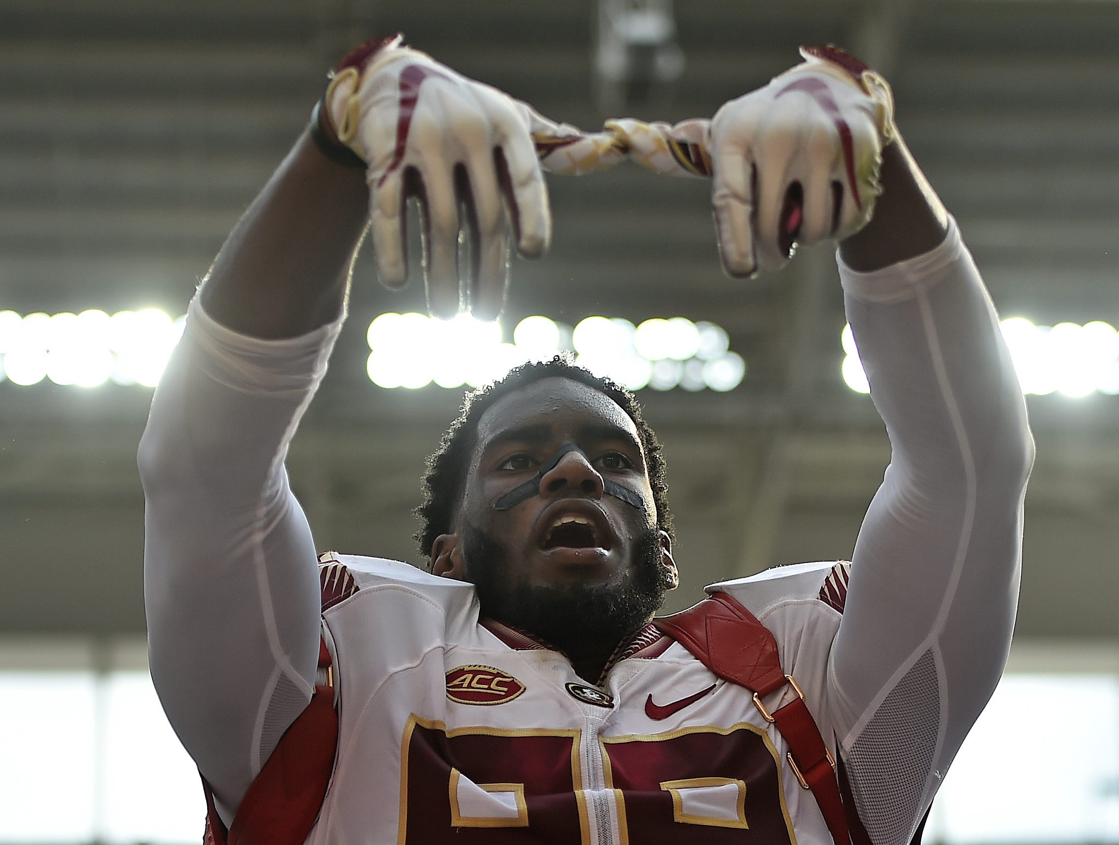 Oct 6, 2018; Miami Gardens, FL, USA; Florida State Seminoles defensive end Brian Burns (99) celebrates with the turn over backpack after receiving a fumble against the Miami Hurricanes during the first half at Hard Rock Stadium. Mandatory Credit: Jasen Vinlove-USA TODAY Sports