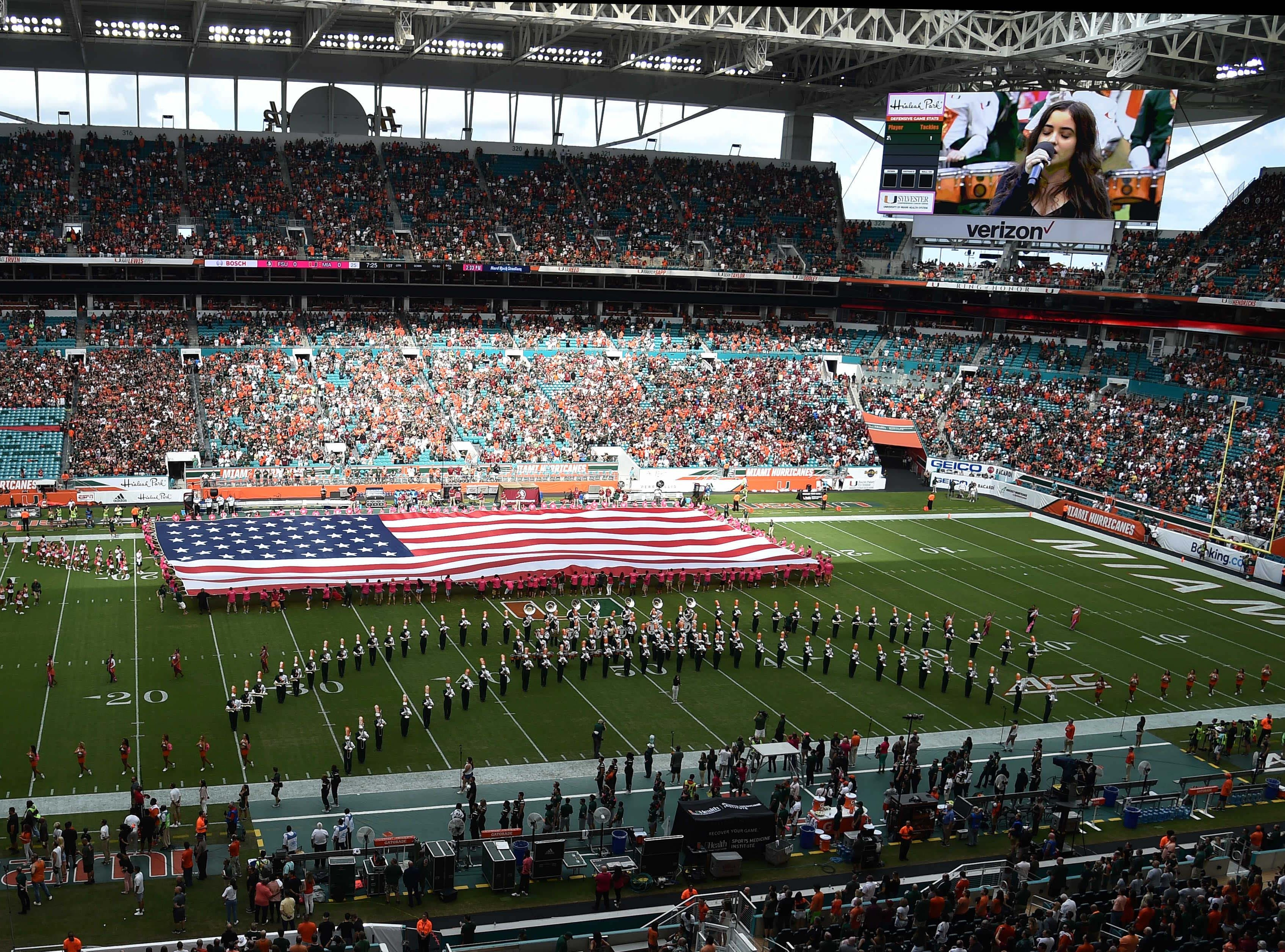Oct 6, 2018; Miami Gardens, FL, USA; A huge American flag is seen during the national anthem before a game between the Florida State Seminoles and the Miami Hurricanes at Hard Rock Stadium. Mandatory Credit: Steve Mitchell-USA TODAY Sports
