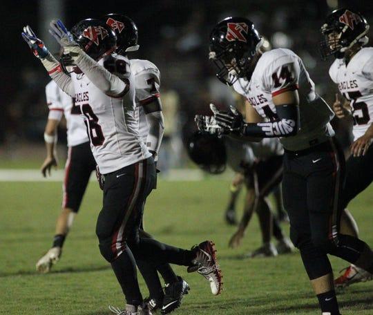 NFC celebrates a third-quarter touchdown against Florida High.