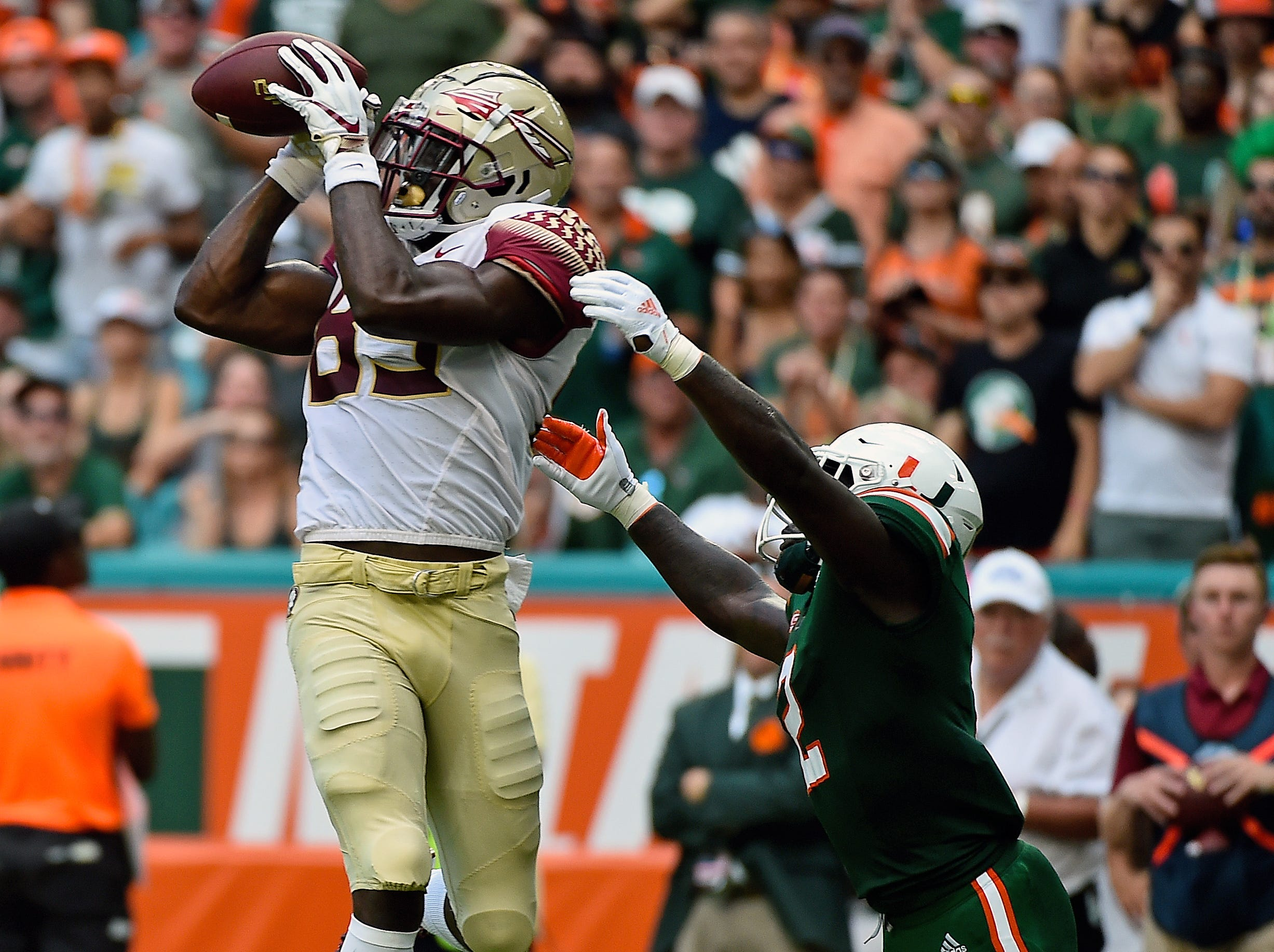 Oct 6, 2018; Miami Gardens, FL, USA; Florida State Seminoles wide receiver Keith Gavin (89) makes a catch for a touchdown against the Miami Hurricanes during the first half at Hard Rock Stadium. Mandatory Credit: Jasen Vinlove-USA TODAY Sports