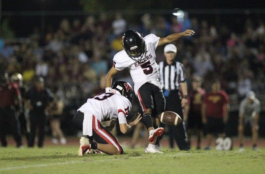 NFC's J.D. Jerry attempts an extra point during a game at Florida High this season.