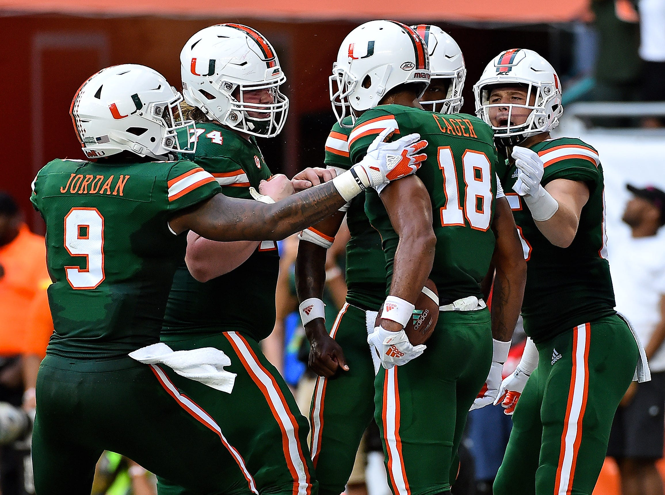 Oct 6, 2018; Miami Gardens, FL, USA; Miami Hurricanes wide receiver Lawrence Cager (18) celebrates after scoring a touchdown against the Florida State Seminoles during the first half at Hard Rock Stadium. Mandatory Credit: Jasen Vinlove-USA TODAY Sports