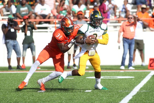 FAMU defensive end Antonio Miller drags down Norfolk State quarterback Juwan Carter. His play helped FAMU secure a 17-0 win over the Spartans.