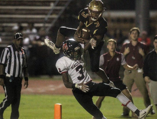 Florida High sophomore wide receiver Ahmari Harvey makes a leaping touchdown catch over NFC's Tredarious Langston with 25 seconds left, helping the Seminoles to a 19-14 win on Friday night.