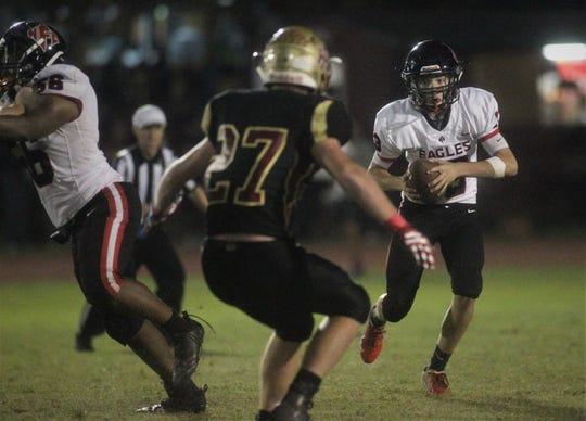 NFC freshman quarterback Drew Faurot reads Florida High's defensive end while running an option play.