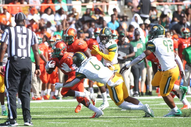 FAMU running back Bishop Bonnett dodges through the Norfolk State defense. He had 12 carries for 80 yards and a touchdown in the 17-0 win.