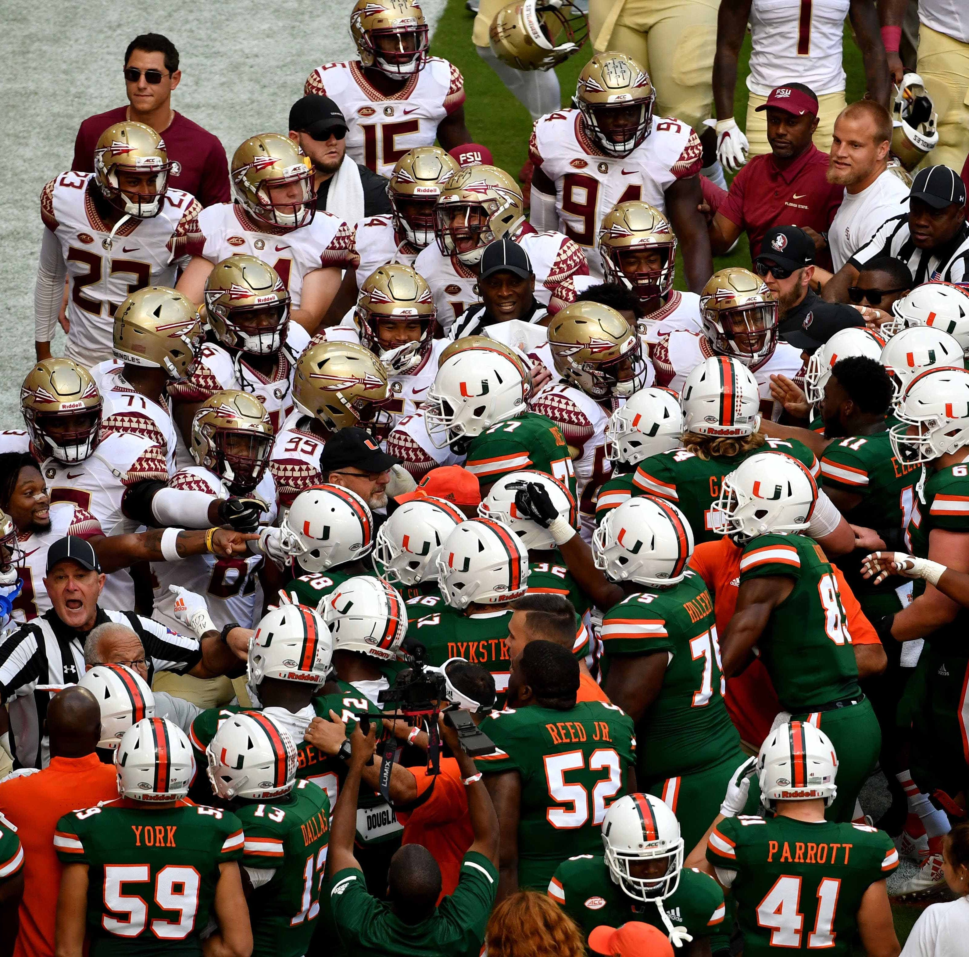 Oct 6, 2018; Miami Gardens, FL, USA; Florida State Seminoles and Miami Hurricanes players react before their game at Hard Rock Stadium. Mandatory Credit: Steve Mitchell-USA TODAY Sports