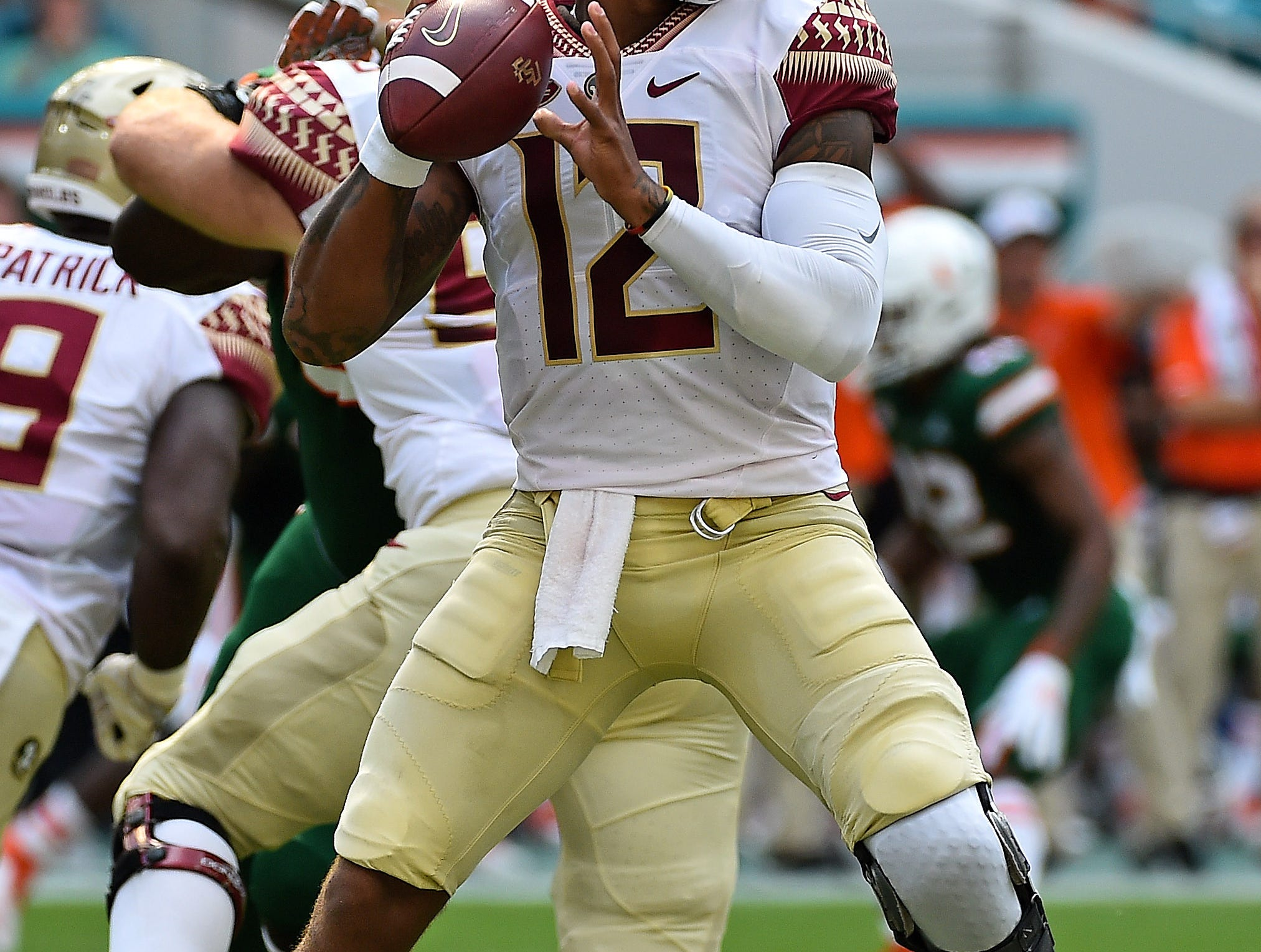 Oct 6, 2018; Miami Gardens, FL, USA; Florida State Seminoles quarterback Deondre Francois (12) attempts a pass against the Miami Hurricanes during the first half at Hard Rock Stadium. Mandatory Credit: Jasen Vinlove-USA TODAY Sports
