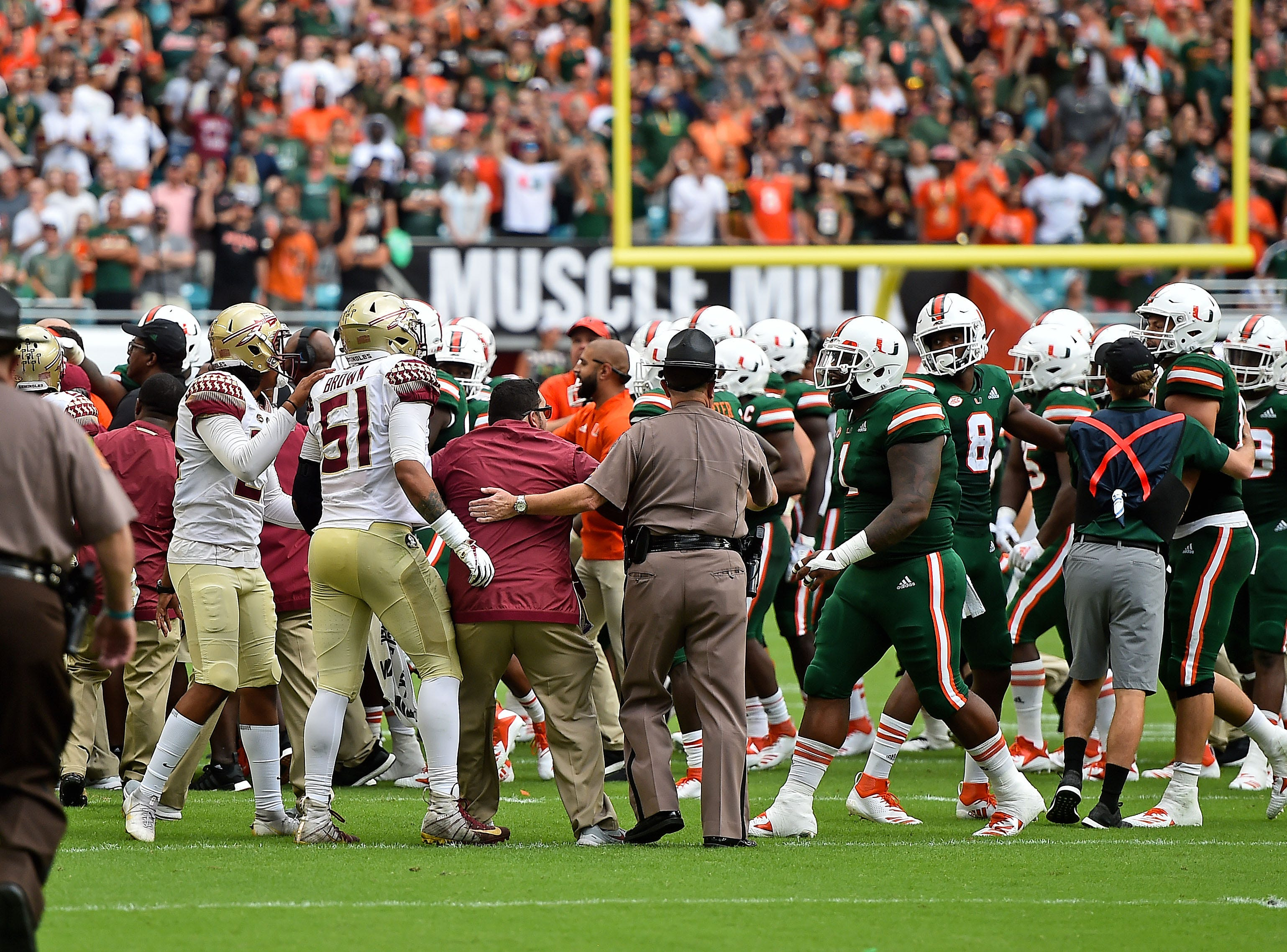 Oct 6, 2018; Miami Gardens, FL, USA; Florida State Seminoles and Miami Hurricanes players scuffle on the field during the first half at Hard Rock Stadium. Mandatory Credit: Jasen Vinlove-USA TODAY Sports