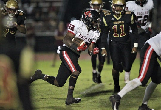 NFC running back Jonathan Railey runs for a 5-yard TD in the first half of a game at Florida High.