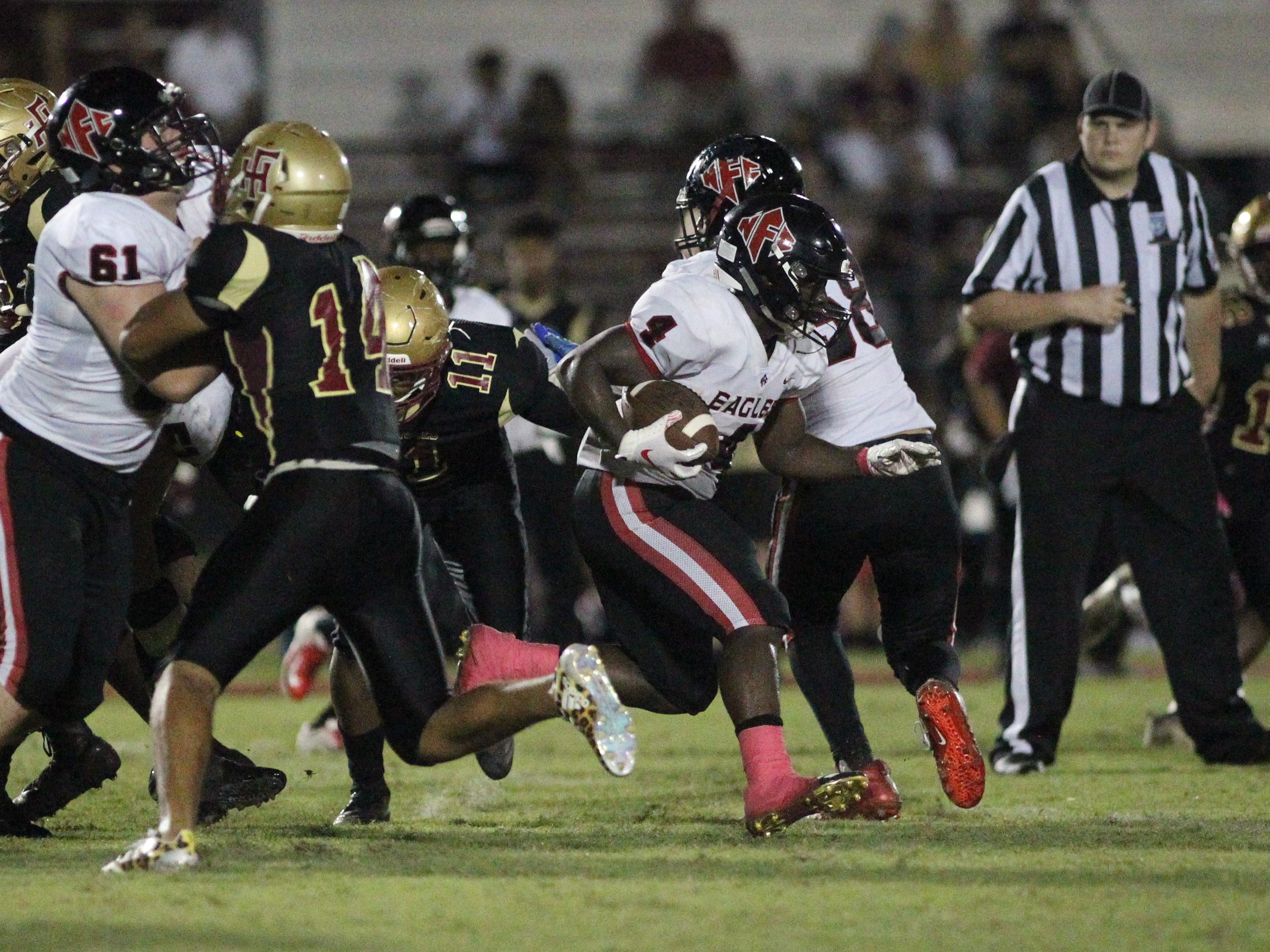 NFC running back Deon Cosby busts through a hole for a big gain against Florida High.