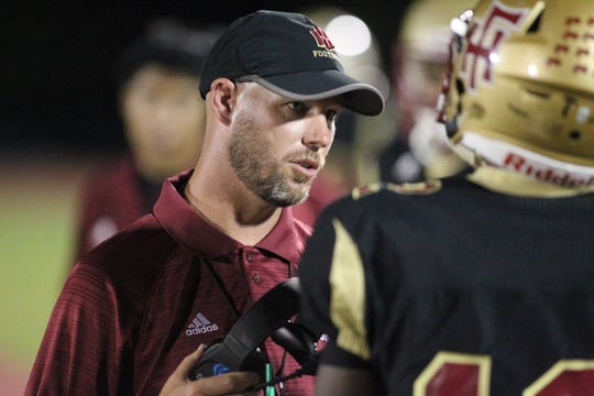 Florida High football coach Jarrod Hickman talks to his team during a game against NFC this season.
