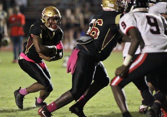 Florida High's Javan Morgan runs for a short touchdown against NFC.