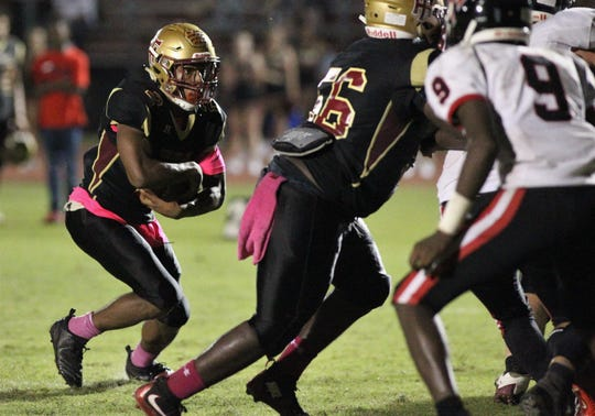 Florida High's Javan Morgan runs for a short touchdown against NFC.