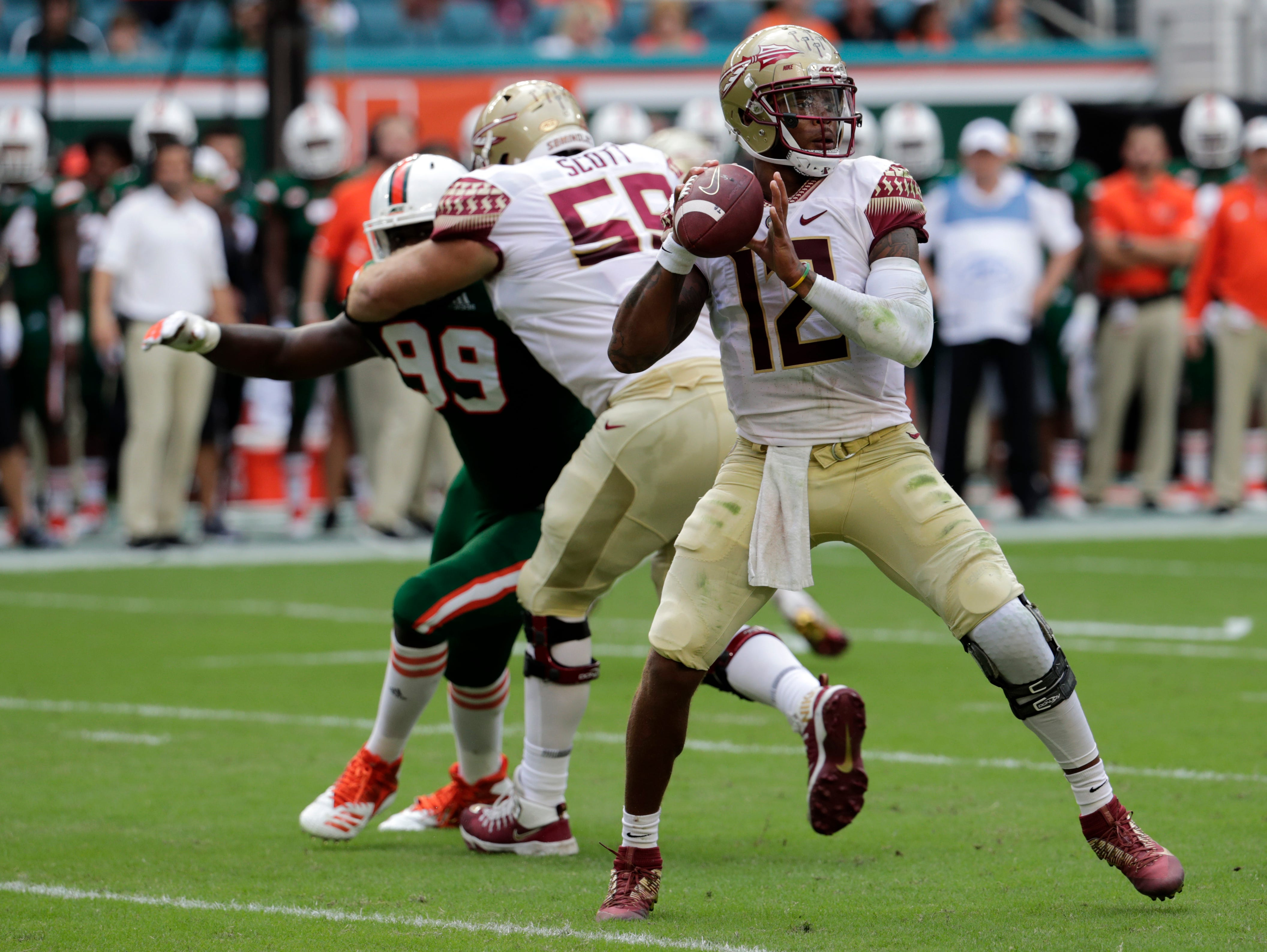 Florida State quarterback Deondre Francois (12) stands back to pass during the first half of an NCAA college football game against Miami, Saturday, Oct. 6, 2018, in Miami Gardens, Fla. (AP Photo/Lynne Sladky)
