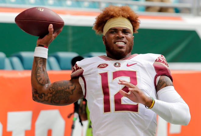 Florida State quarterback Deondre Francois (12) warms up before an NCAA college football game against Miami, Saturday, Oct. 6, 2018, in Miami Gardens, Fla. (AP Photo/Lynne Sladky)